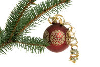 Shot for stock photography. A red Christmas ornament hangs on a pine branch. Photographed in our studio.