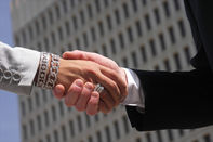 Shot for stock photography. Male and female shaking hands while in business attire showing agreement or concluding a deal.